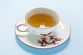 Tea in Asian cup and saucer