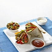 Chicken and vegetable fajitas with spicy plum dip