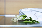 Spring onions wrapped in a tea towel
