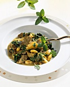 Duck curry with almonds, coconut milk and mint