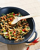 Chicken with cashew nuts in wok