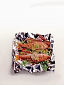 Red mullet with vegetables and herbs on aluminium foil