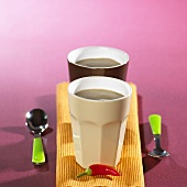 Two mugs of chilli chocolate