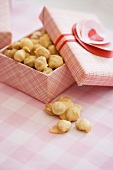 Opened Box of Toffee Covered Macadamia Nuts; For Valentine's Day