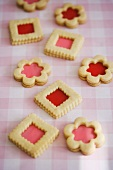 Pink and Red Filled Cookies on Checked Cloth