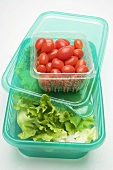 Lettuce in food storage box, tomatoes in plastic punnet