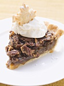 Piece of pecan pie with cream
