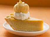 Piece of pumpkin pie with cream and pastry pumpkin