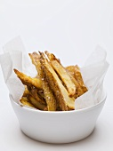 Salted chips in bowl lined with paper