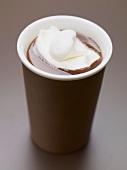 Hot chocolate with cream in beaker