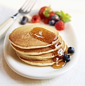 Stack of Pancakes with Maple Syrup with Berries