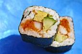 Two maki sushi made with surimi