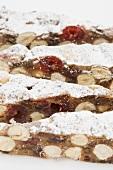 Panforte (Italian fruit cake) with icing sugar