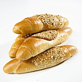 Several grain baguettes, stacked