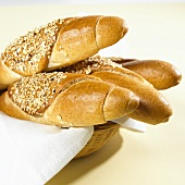 Several grain baguettes in a bread basket