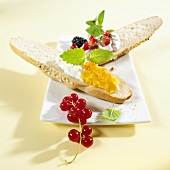 Grain baguette topped with jam, quark and berries