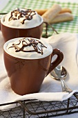 Hot chocolate with cream topping and chocolate decoration