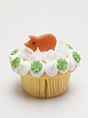 Cupcake with lucky pig and clover leaves