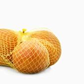Three grapefruits in a net