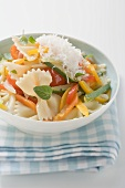 Farfalle primavera with vegetables and grated cheese
