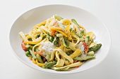 Tagliatelle primavera with vegetables and grated cheese