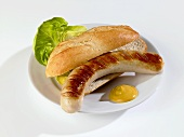 Grilled sausage in bread roll with mustard