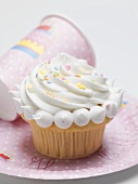 Muffin with meringue topping and sprinkles