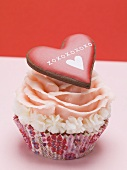 Cup cake with marzipan rose and pastry heart