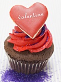 Chocolate muffin with red cream and vanilla heart
