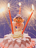 Small cake with clown & sparklers for child's birthday
