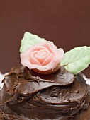 Chocolate cake with marzipan rose (close-up)