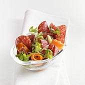 Salami salad with carrots and baby corn