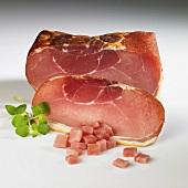 Schinkenspeck (dry-cured pork) and fresh oregano