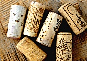 Various wine corks on wooden background