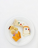 Various cheeses on plate with flags