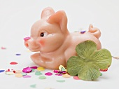 Marzipan pig, four-leaf clover and confetti