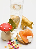 Glass of sparkling wine, salmon appetiser and lucky charms