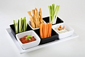 Tray of vegetable sticks, savoury straws and dips