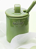 A green ceramic pot with lid and the word 'Relish'