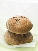 Two crusty brown rye rolls