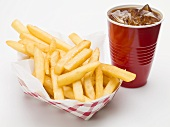 A portion of chips with cola in fast food containers