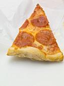 A slice of salami pizza