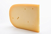 A piece of Gouda cheese