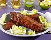 Spare ribs garnished with lettuce leaves