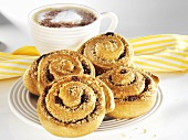 Wholemeal cinnamon buns with nuts and raisins, with coffee