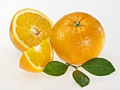 Oranges (whole, half and wedge) with leaves