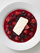 White chocolate mousse with berry sauce (overhead view)