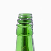 Green beer bottle necks in a row