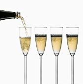 Pouring sparkling wine into glasses