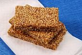 Three bars of sesame brittle lying on napkin
